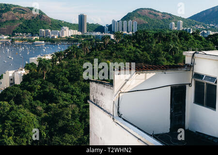 Abstract concept of doorway leading towards tropical rainforest and bay in Botafogo, Rio de Janeiro, Brazil - Stock Image