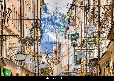 Guild signs, Getreidegasse pedestrian mall, Salzburg, Austria - Stock Image