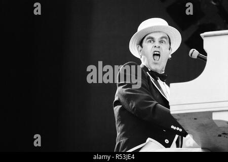 'Summer of 84' Elton John concert at Wembley Stadium, during the European Express Tour, which was the European leg of his 1984 Breaking Hearts Tour. 30th June 1984. - Stock Image