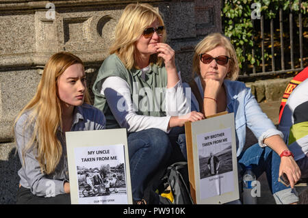 London, UK. 13th October 2018. Members of the family of Tony Spink, a cyclist who was killed by a lorry which dragged him  150 metres but failed to stop take part in the funeral procession of cyclists behind a horse-drawn hearse to highlight the failure of governments from all the major parties to take comprehensive action on safer cycling. Stop Killing Cyclists call for £3 billion a year to be invested in a national protected cycling network and for urgent action to reduce the toxic air pollution from diesel and petrol vehicles which kills tens of thousands of people every year, and disables  - Stock Image