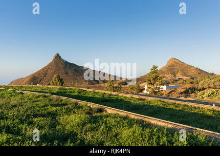 Roque Imoque and an agricultural landscape at Ifonche, Arona, Tenerife, Canary Islands, Spain - Stock Image