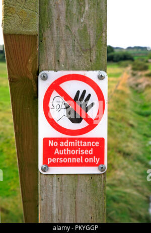 A No admittance Authorised personnel only sign by the Norfolk Coast Path at Morston, Norfolk, England, United Kingdom, Europe. - Stock Image