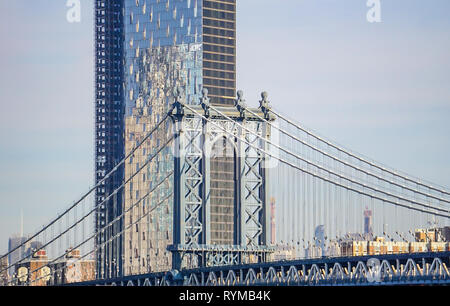 A view of Manhattan Bridge and the cityscape from the Brooklyn Bridge in New York City, New York, USA - Stock Image