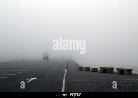 Summer fog over parking spaces in Promenade de Penarth, Vrennit, Saint Pol de Leon, Finistere, Brittany, France - Stock Image