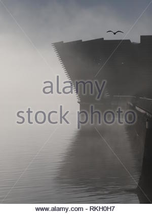 V&A Design Museum reflected in River Tay with fog Dundee Scotland  January 2019 - Stock Image