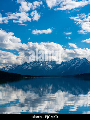 Blue Sky Over Blue Waters of Jackson Lake with Tetons - Stock Image