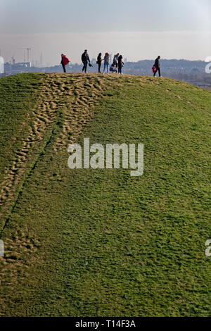 People viewing the City Of London in the distance from the top of a mound in Northala fields Park, Northolt, middlesex - Stock Image