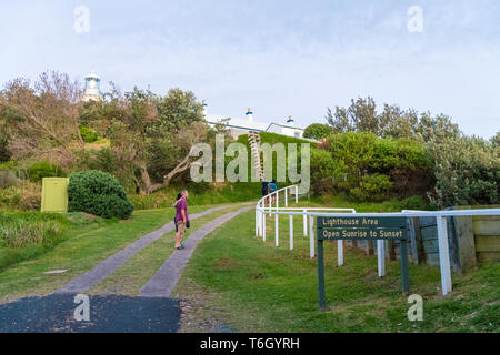 Seal Rocks, NSW, Australia-April 20, 2019: People visiting the lighthouse at Sugarloaf Point Seal Rocks, Myall Lakes National Park, New South Wales, A - Stock Image