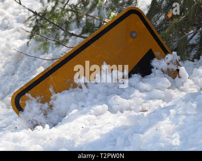 Quebec,Canada. Snow buried advanced warning road sign. - Stock Image