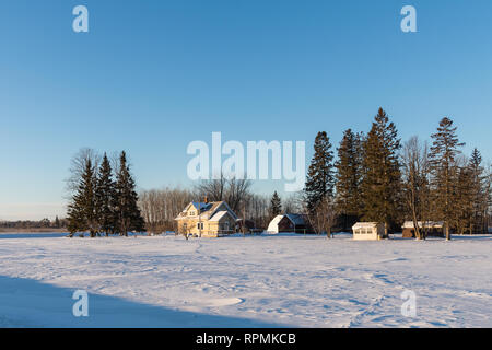 Houses and trees in a snow covered field. Duluth, Minnesota, USA. - Stock Image