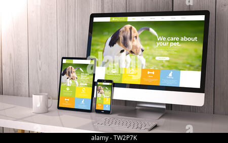 Digital generated devices on desktop, responsive pet website design on screen. All screen graphics are made up. 3d rendering. - Stock Image