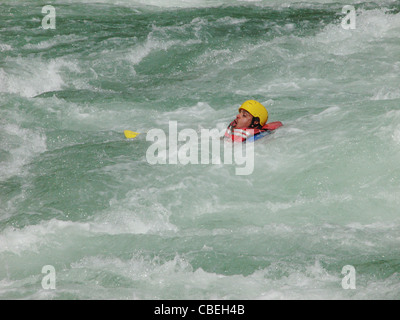 Man falls out raft and fights to stay above water - Stock Image