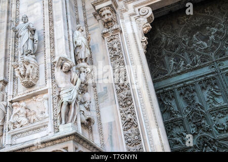 Architectural closeup of ornate decorative details on exterior of gothic Milan Cathedral (Duomo), Milan, Italy - Stock Image