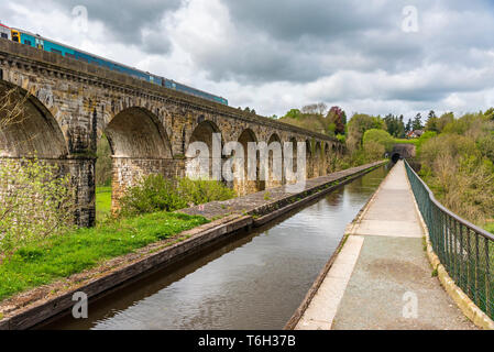 The Chirk aqueduct and railway viaduct over the Ceiriog valley North Wales. THe Shropshire Union canal at Chirk with the Chirik tunnel in the distance - Stock Image