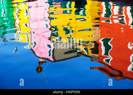 Reflection of a colorful houses in water canal, Burano island, Venice, Veneto region, Italy - Stock Image