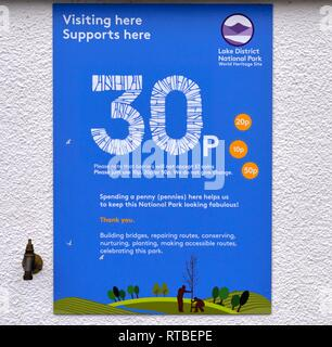 Spending a penny, cost of using toilets sign,Coniston,Cumbria,England,UK - Stock Image