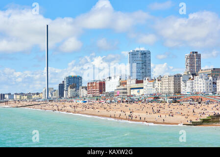 Side-view of Brighton seafront featuring British Airways 1360 viewing tower. - Stock Image
