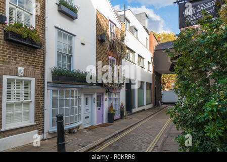 Perrin's Court, a pretty narrow street of shops, houses, cafes and restaurants, Hampstead, London, England, UK - Stock Image