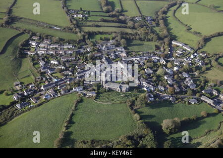 An aerial view of the village of Ugborough and surrounding Devon countryside - Stock Image