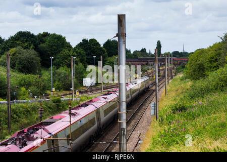 Virgin Pedolino express passenger train heading north on the West Coast Main Line, near Farington curve junction, Preston, Lancashire. - Stock Image