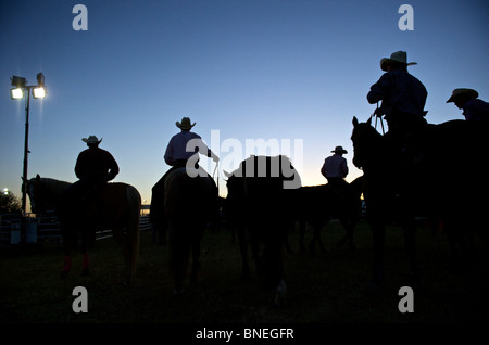 Cowboy members of PRCA at backstage for rodeo event in Bridgeport, Texas, USA - Stock Image