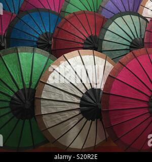 Parasols in market stall in Luang Prabang Laos - Stock Image