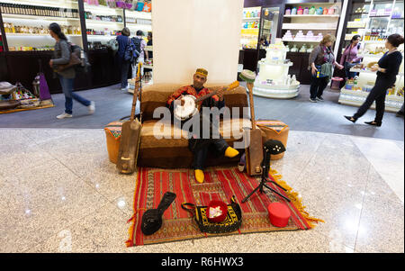 Marrakech airport - a musician in the Departure lounge, Marrakech airport, Marrakesh Morocco North Africa - Stock Image