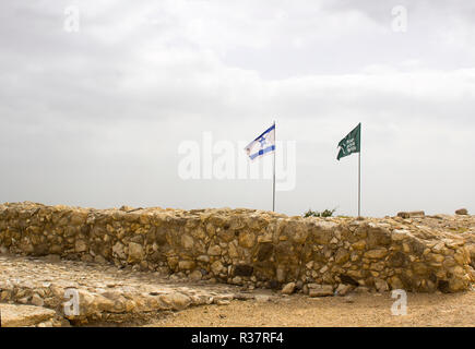 Israeli Flags aloft among the excavated ruins in the ancient city of Meggido Israelin the ancient city of Meggido in Northern Israel. This place is ot - Stock Image