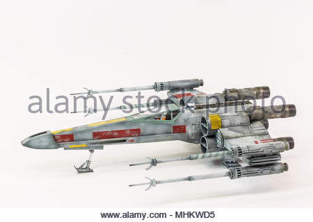 Revell boxing of the Fine Molds 1/48 plastic construction kit of Luke Skywalker's Red 5 Income T-65 X-Wing fighter from the Star Wars films - Stock Image