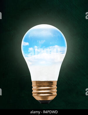 Blue sky inside floating light bulb with copy space. Concept of ecology, environmental conservation; green alternative. - Stock Image