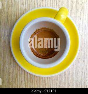 Espresso coffee in yellow cup and saucer - Stock Image