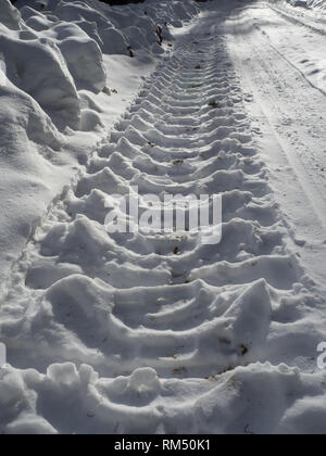 Skidmark in snow - Stock Image