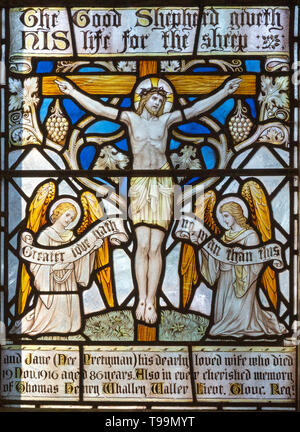Victorian 19th century stained glass window Jesus Christ crucifixion with angels, Waldringfield church, Suffolk, England, UK - Stock Image