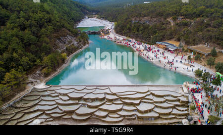 Lijiang. 21st Apr, 2019. Aerial photo taken on April 21, 2019 shows the scenery of Blue Moon Valley in Lijiang, southwest China's Yunnan Province. According to local authority, tourism started to heat up when a faster train service was launched between Lijiang and provincial capital Kunming in early 2019. During the first season, Lijiang welcomed 12.325 million arrivals and saw a total revenue of 25.637 billion yuan, up 21.5 percent and 15.13 percent respectively than the previous year. Credit: Hu Chao/Xinhua/Alamy Live News - Stock Image