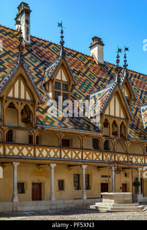 The Hospices de Beaune or Hotel-Dieu de Beaune, a medieval hospital in the town of Beaune in the Burgundy region of eastern France. Founded in 1443, i - Stock Image