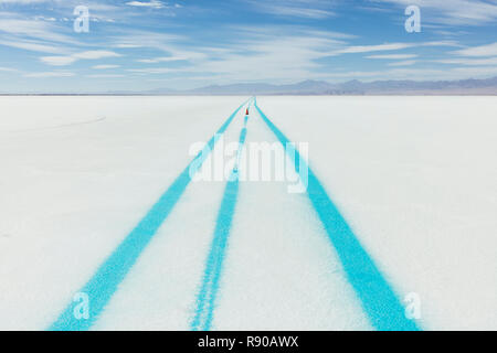 Painted blue line on Salt Flats, marking race course - Stock Image