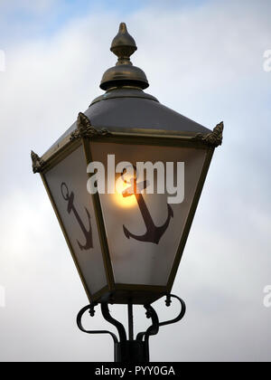 Old fashioned lamp with an anchor - Stock Image