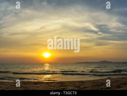 Sky and water at colorful sunset over sea - Stock Image