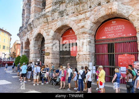 VERONA, ITALY - SEPTEMBER 2018: People queuing for tickets for the Verona Arena. It is a Roman amphitheatre in the city centre and is used for classic - Stock Image
