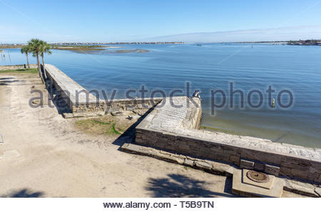 A young couple takes a selfie at a point of the seawall at the Castillo de San Marcos, a Spanish fortification at St. Augustine, Florida USA - Stock Image