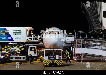 An Easyjet aeroplane on the runway at night - Stock Image