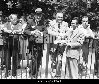 Clyde Tolson, J. Edgar Hoover and Sam Wm. Renick at Belmont Park Race Track, NY June 6, 1953 - Stock Image