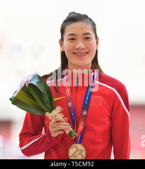 Doha, Qatar. 23rd Apr, 2019. Lu Minjia of China reacts during the victory ceremony of the women's long jump final during 23rd Asian Athletics Championships at Khalifa International Stadium in in Doha, capital of Qatar, April 23, 2019. (Xinhua/Wu Huiwo) Credit: Wu Huiwo/Xinhua/Alamy Live News - Stock Image
