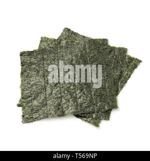 Sheets of dried green nori isolated on white background - Stock Image
