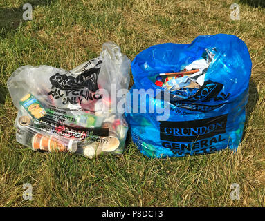 Two campsite bags, general waste and recycling camping field, clear bag, blue bag, Grundon , Recycling Only - Stock Image