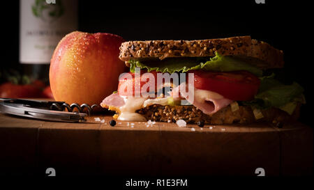 lunchtime seeded brown bread ham cheese and tomato sandwich - Stock Image