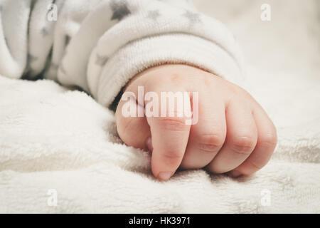Macro close up on newborn's hand - Stock Image