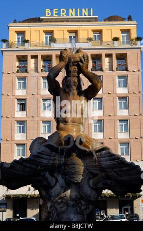 Bernini's Fontana del Tritone (Triton Fountain) with background of apartment building with Bernini sign, Piazza - Stock Image