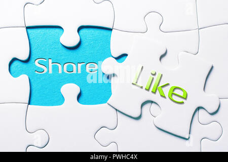 The Social Media Words Share And Like In Missing Piece Jigsaw Puzzle - Stock Image