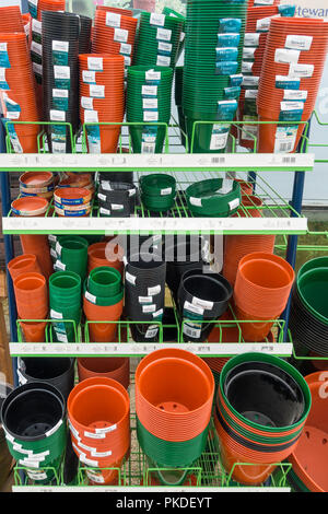 A garden centre display  of eco friendly Stewart plant pots bio degradable in landfill after use - Stock Image
